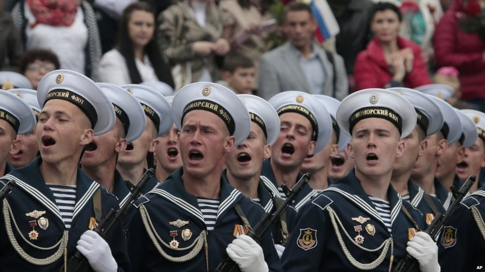 Russian Black Sea fleet sailors salute during the Victory Day military parade, which commemorates the 1945 defeat of Nazi Germany, in Sevastopol, Russia, 9 May 2014