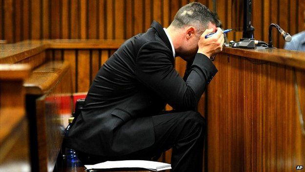 Oscar Pistorius cradles his head in his hands during court proceedings in Pretoria - 5 May 2014