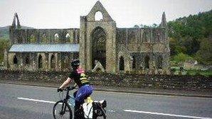 Angela whizzing past Tintern Abbey