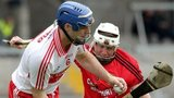 Derry's Liam Hinphey and Down's Michael Ennis