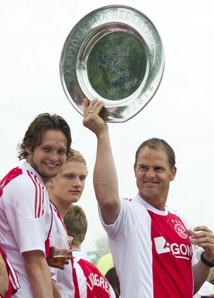 Ajax manager Frank de Boer celebrates with the Eredivisie trophy