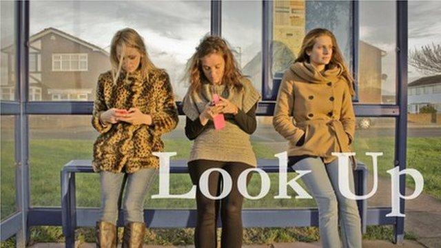 Three women at bus stop