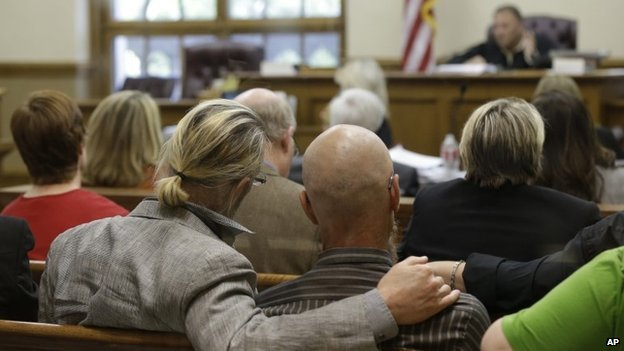 Spectators watch at the Pulaski County Court House in Little Rock