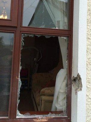Window broken by pipe bomb