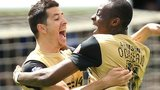 Moses Odubajo celebrates his equaliser with Leyton Orient teammate Lloyd James