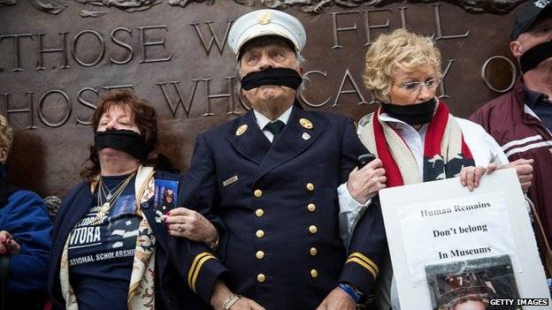 """Al Santora (C), father of Christopher Santora, a victim of the September 11, 2001 attack, and other victim""""s family members protest the decision by city officials to keep unidentified human remains of the 9-11 victims at the 9-11 Museum at the World Trade Center site, on May 10"""