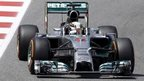 Lewis Hamilton beats Rosberg to pole