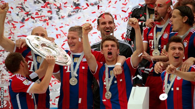 Bayern Munich players celebrate winning the Bundesliga