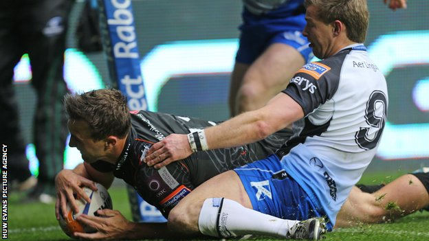 Ashley Beck scores the second Ospreys try despite Kieran Marmion's efforts