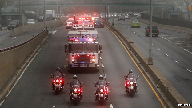 Police and fire department vehicles lead a procession along Franklin D. Roosevelt East River Drive with the unidentified remains of victims of the Sept. 11, 2001 attacks as they are returned to the World Trade Center site, Saturday, May 10
