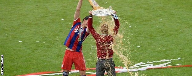 Bayern Munich manager Pep Guardiola is showered in beer after his team's final game of the season