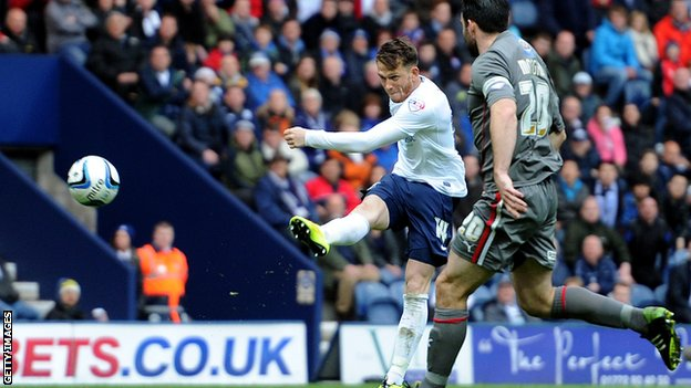 Preston North End's Joe Garner scores the equaliser against Rotherham