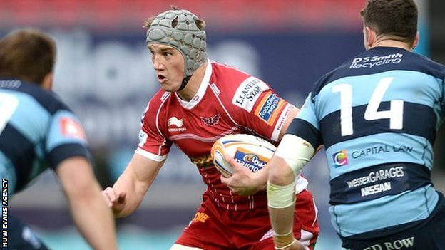 Jonathan Davies takes on Blues Simon Humberstone (left) and Alex Cuthbert