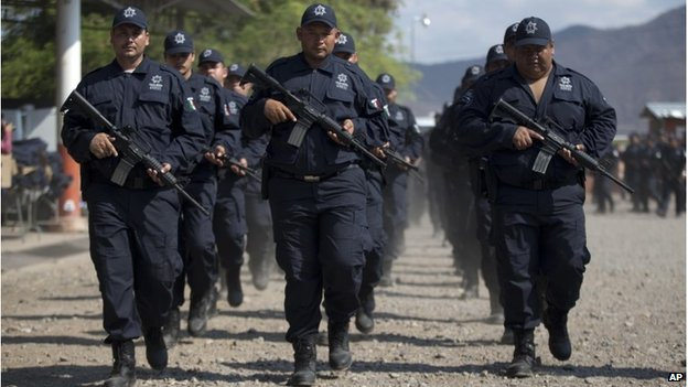 New rural officers march in Michoacan