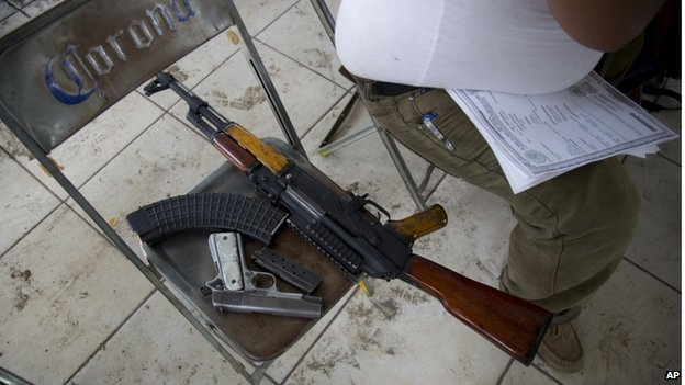 Man waits to register his guns in Mexico