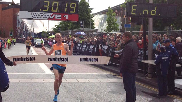 Scott Overall crossing the finish line