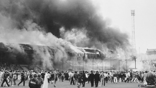 Fire at Valley Parade and fans on the pitch