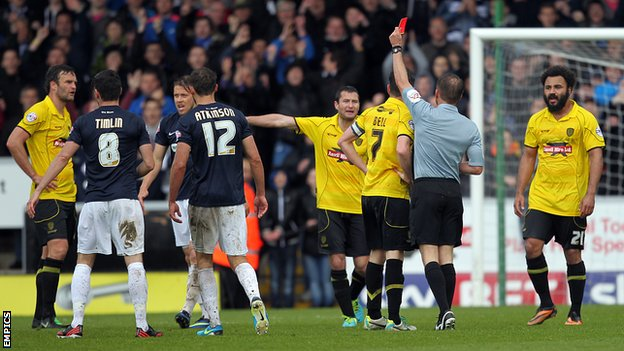 Ian Sharps (far left) is sent off by referee Oliver Langford