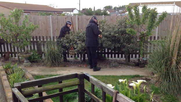 Police in a garden in Hemsby