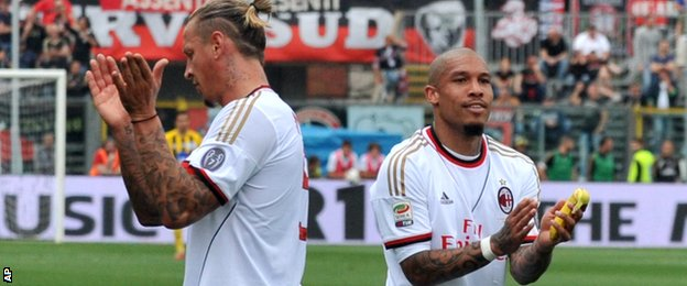 Philippe Mexes and Nigel de Jong of AC Milan