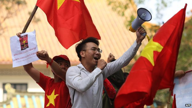 Protesters shout slogans outside the Chinese embassy
