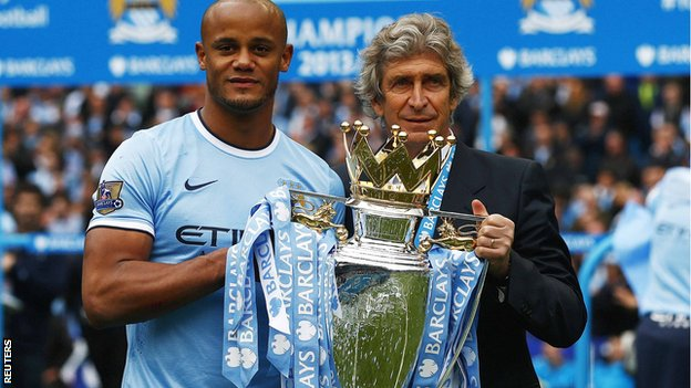 Manchester City captain Vincent Kompany and manager Manuel Pellegrini with the Premier League trophy