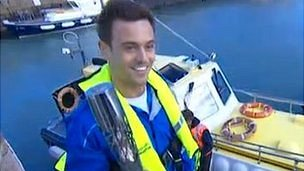 Tom Daley arrives in St Aubin, Jersey, with baton