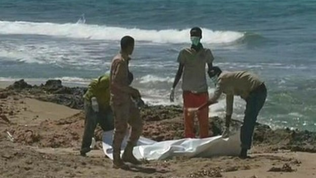 At least 40 die after migrant boat sinks off Libya, still from Reuters footage