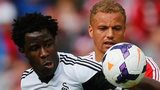 Wilfried Bony takes on Sunderland's Wes Brown
