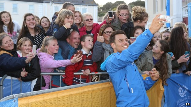 Tom Daley takes selfie with people in St Aubin