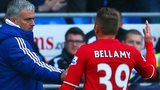 Craig Bellamy is greeted by Jose Mourinho as he leaves the field at