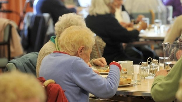 Old people eating a meal
