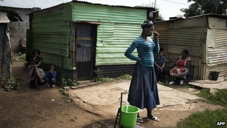 Relatives of striking miners are seen idling in the impoverished informal camp just outside the South African Platinum hub of Marikana