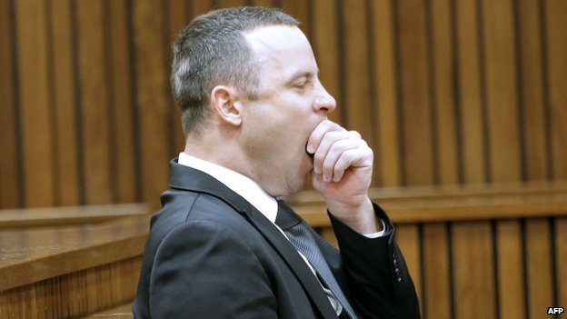 South African Paralympic athlete Oscar Pistorius yawns in the dock during his trial in Pretoria (12 May 2014)