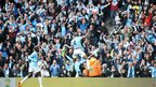 Vincent Kompany celebrates in front of fans at the Etihad stadium