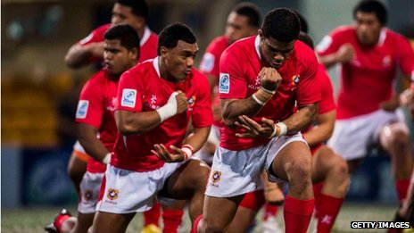 Tonga players perform the haka