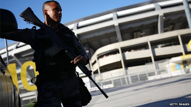 An armed policeman outside the Maracana football stadium in Rio de Janeiro, Brazil