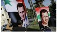 Workers erect pro-Assad campaign billboards in Damascus (11/05/14)