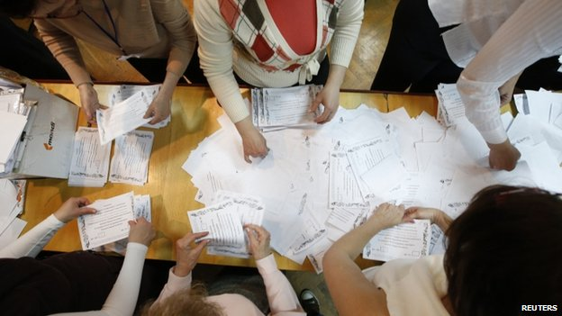 Members of a local election commission count votes of the referendum on the status of Donetsk region in Donetsk