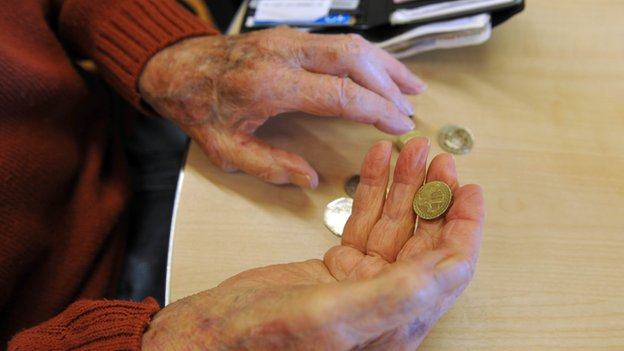 Pensioner handling money