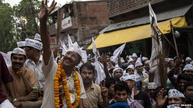 AAP leader Arvind Kejriwal waves to supporters during a rally in Varanasi