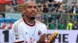 AC Milan midfielder Nigel De Jong holding a banana thrown at him by Atalanta fans in a Serie A match