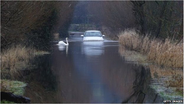 A car drives through flood water near Langport