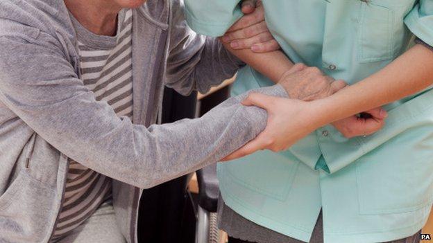 Nurse helping elderly person