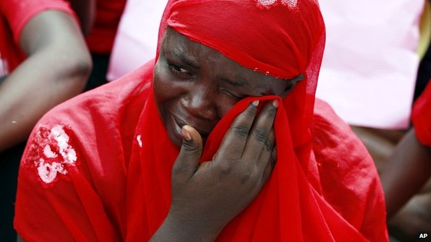 A woman attends a demonstration calling on the government to rescue the kidnapped schoolgirls in Abuja - 6 May 2014