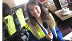 Female School Reporter in high vis vest