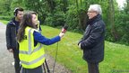 Female School Reporter in high vis vest and cameraman interviewing local politician