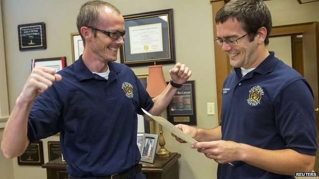 Firefighters Steven Gibson (left) and Mark Hightower celebrate marrying at the Pulaski County Courthouse in Little Rock