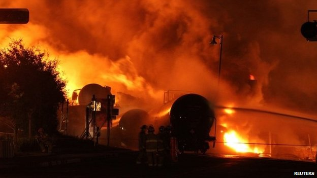 Firefighters battle the blaze at Lac-Megantic (6 July 2013)