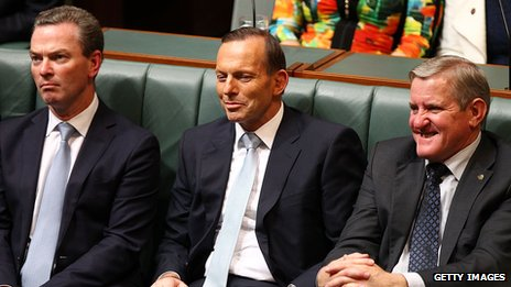 Australian Prime Minister Tony Abbott listening to the budget being delivered